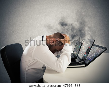 Businessman overworked worn computers
