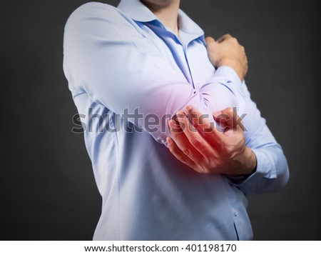 Businessman pain on his elbow
