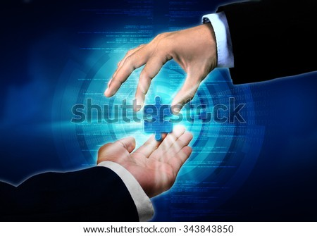 Businessman passing on the important piece information puzzle to another businessman