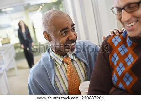 Businessman Patting Co-Worker on Back - stock photo