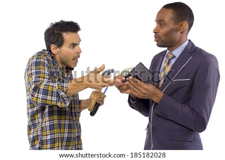businessman paying hired blue collar laborer for services - stock photo