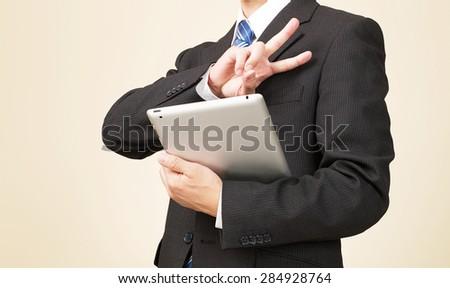 businessman peace sign gesture - stock photo