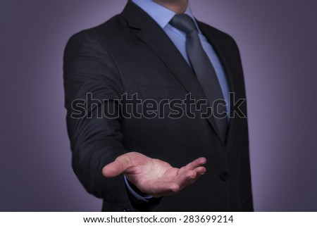 Businessman performing a hand gesture  - stock photo