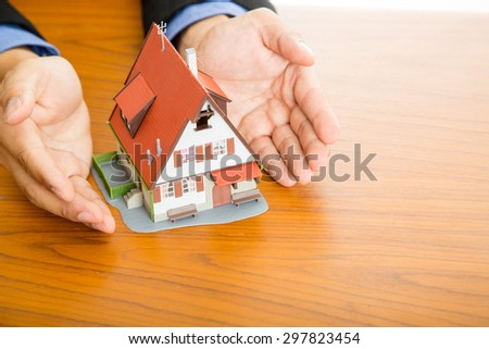 Businessman plan and suggest for  good property with real agency property concept. - stock photo