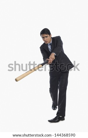 Businessman playing baseball - stock photo