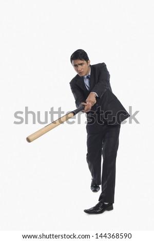Businessman playing baseball - stock photo