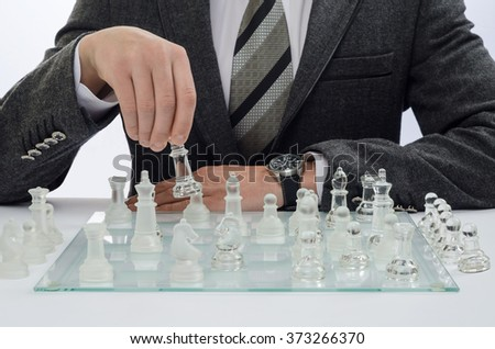 businessman playing chess on a light background