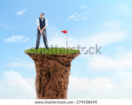 Businessman playing golf - stock photo