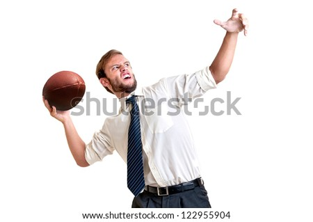 Businessman playing rugby isolated in white - stock photo