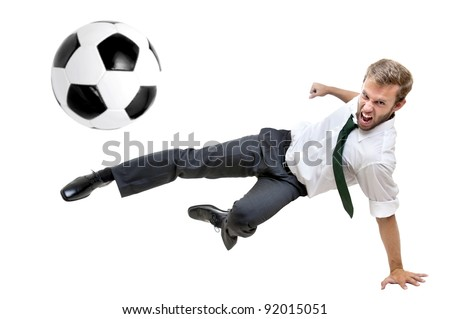 Businessman playing soccer isolated in white