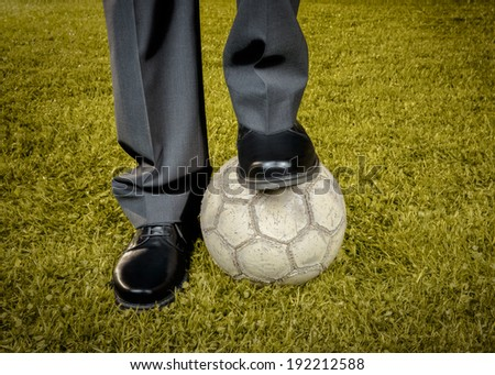 Businessman playing with soccer ball - retro style