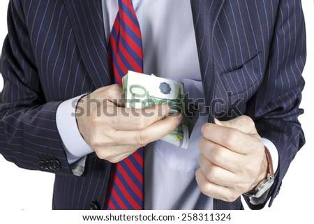 Businessman pocketing a bribe - stock photo