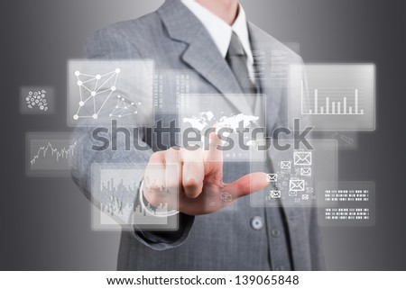 businessman point finger at a touch screen - stock photo