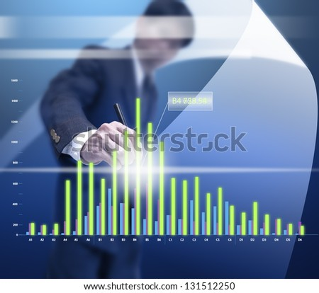 businessman point to read a part of virtual graph. - stock photo
