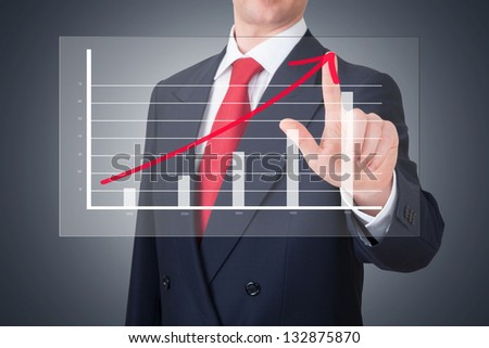Businessman pointing a graph wich shows the progress of the business - stock photo