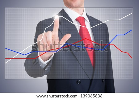 Businessman pointing a graph witch shows the progress of the business