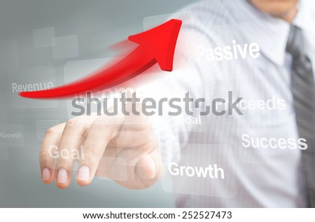 Businessman pointing a rising arrow, representing business growth.