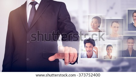 Businessman pointing against light grey