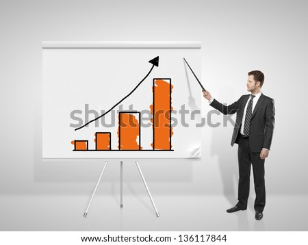businessman pointing at business chart on flip chart - stock photo
