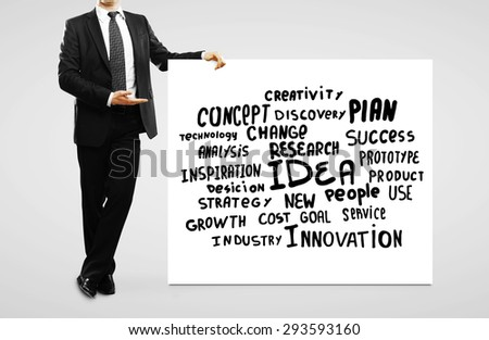 businessman pointing at  business tags on placard - stock photo