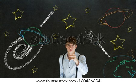 Businessman pointing at chalk universe planet solar system on blackboard imagining space travel - stock photo