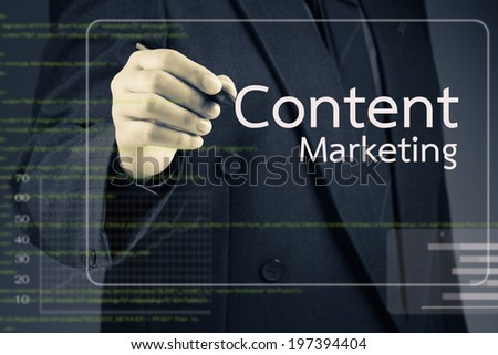 Businessman pointing at Content Marketing article on screen - stock photo