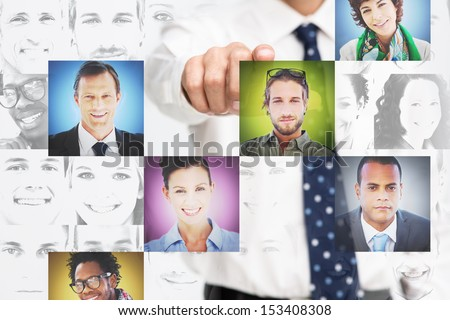 Businessman pointing at digital interface presenting profile pictures on white background