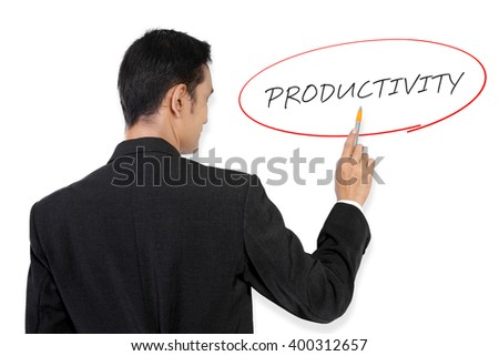 "Businessman pointing at ""Productivity"" handwritten text on white board with his pen"