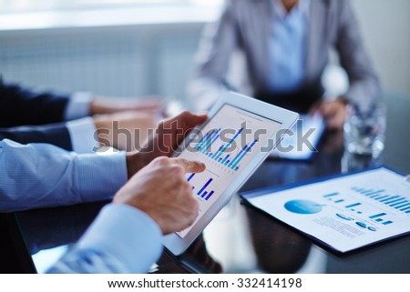 Businessman pointing at touchscreen with chart - stock photo