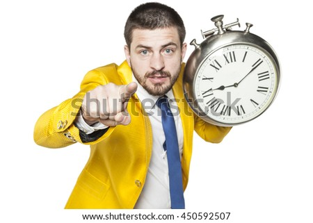 businessman pointing at you, holding a clock in his hand