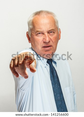 Businessman pointing at you on gray background