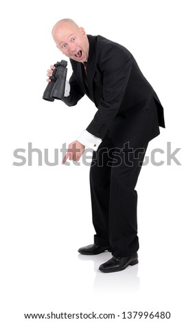 Businessman pointing down to copy space after finding something with Binoculars isolated on white - stock photo