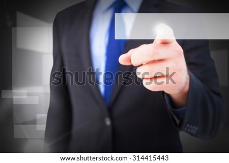 Businessman pointing his finger at camera against abstract room