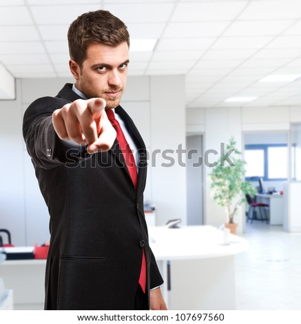 Businessman pointing his finger at you - stock photo