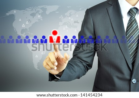 Businessman pointing human sign - HR,HRM,HRD ,CRM concept - stock photo