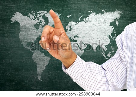 businessman pointing index on classroom media continents over green board - stock photo