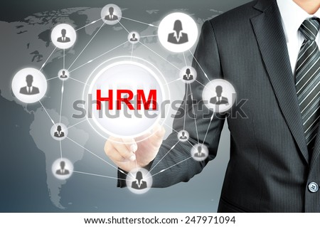 Businessman pointing on HRM (Human Resource Management ) sign on virtual screen with people icons linked as network - stock photo