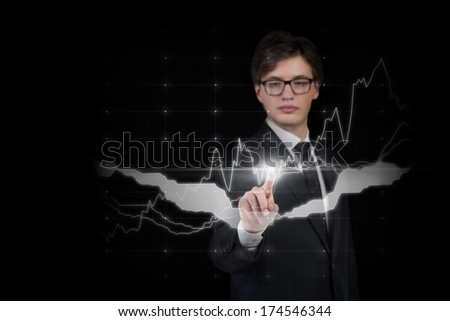 Businessman pointing on the graph - stock photo