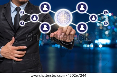 Businessman pointing or touching the Social media symbol on Blurred Photo bokeh of cityscape, Elements of this image furnished by NASA, Business network concept - stock photo
