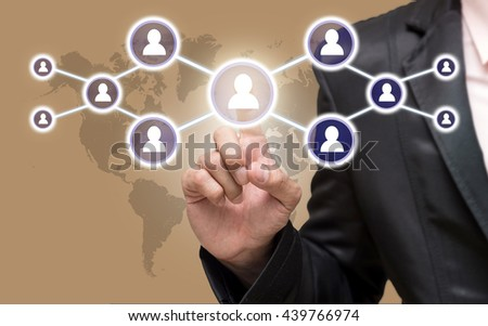Businessman pointing or touching the Social media symbol on ice coffee color background with world map,Elements of this image furnished by NASA, Business network concept