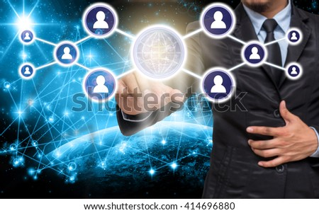 Businessman pointing or touching the Social media symbol on Internet network concept background,Elements of this image furnished by NASA, Business network concept