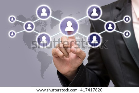 Businessman pointing or touching the Social media symbol on world map,Elements of this image furnished by NASA, Business network concept