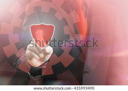 Businessman Pointing Shield Icon of Virtual Touchscreen in Virtual Security Concept Image - stock photo