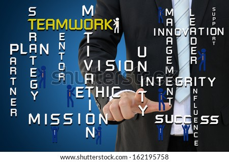 Businessman pointing teamwork puzzle concept - stock photo
