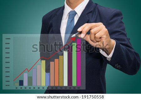 businessman pointing to bargraph