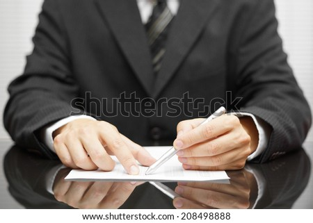 businessman pointing to mistake in report - stock photo