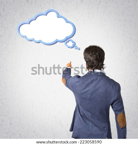 Businessman pointing to the lateral over grey background - stock photo
