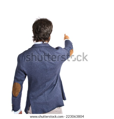 Businessman pointing to the lateral over white background - stock photo