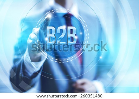 Businessman pointing towards camera selecting business to business , virtual interface - stock photo