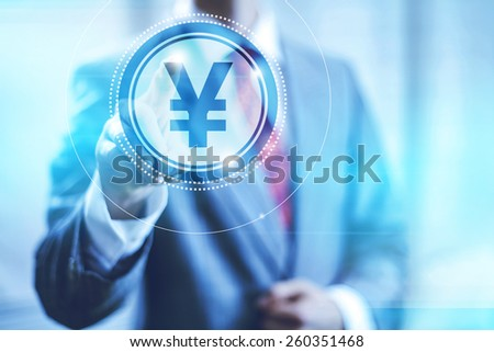 Businessman pointing towards camera selecting Yen sign , virtual interface - stock photo